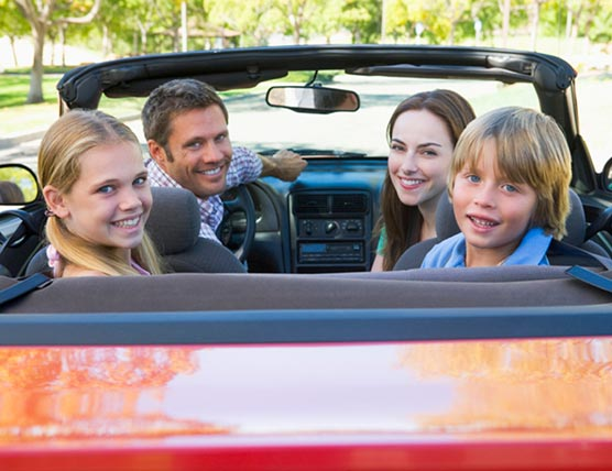 Family Driving in convertable car